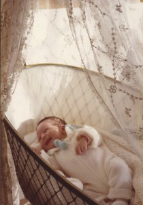 Alex Terrier in a crib